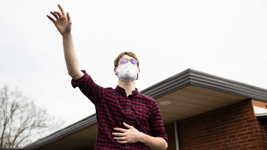 In this April 12, 2020, file photo, a devotee worships while wearing a face mask as a preventive measure against COVID-19 during an Easter Sunday church service in Ohio.
