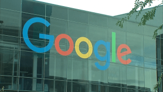 Exterior of Google headquarters with company logo.