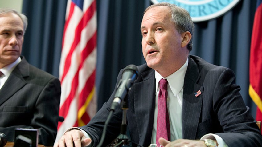 Texas Attorney General Ken Paxton holds a joint press conference Feb. 18, 2015 with Texas Gov. Greg Abbott, l, to address a Texas federal court's decision on the lawsuit filed by 26 states challenging President Obama's executive action on immigration. Paxton was indicted Aug. 3, 2015 on three counts of securities fraud not related to his official duties.